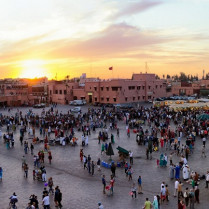 MARRAKESH, MOROCCO - APR 29, 2016: Tourists and locals on the Djemaa-el-Fna square during sunset in Marrakesh.